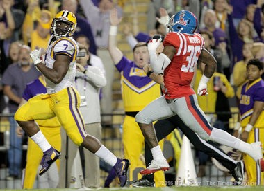 LSU Tigers running back Leonard Fournette (7) scores during first half action against the Mississippi Rebels in Baton Rouge on Saturday.