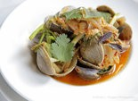 Clams in kimchi broth with fresh herbs at La Petite Grocery (Dinah Rogers Photo)
