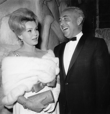 Actress Zsa Zsa Gabor and husband Herbert Hutner arrive for the New York premiere of the film 'The Ugly American' in April 1963. (AP Photo/Marty Lederhandler, File)