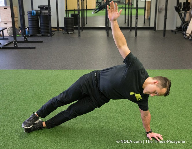 Colin Brunet demonstrates the 'Oblique or Side Plank Drop.' (Photo by Ted Jackson, NOLA.com   The Times-Picayune)