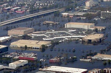 The Lake Forest Plaza shopping mall in New Orleans East is shown covered in flood waters after Hurricane Katrina in 2005. (The Times-PIcayune archive)