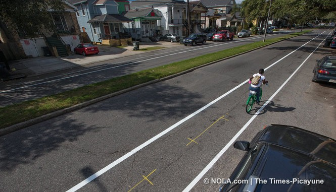 Bicyclists enjoy the new bike lanes on Banks St. between Jefferson Davis and Carrollton Ave. as workers with Pavement Markings, LLC put the finishing touches on the stretch of roadway, Thursday, February 2, 2017. (Photo by Ted Jackson, NOLA.com | The Times-Picayune)