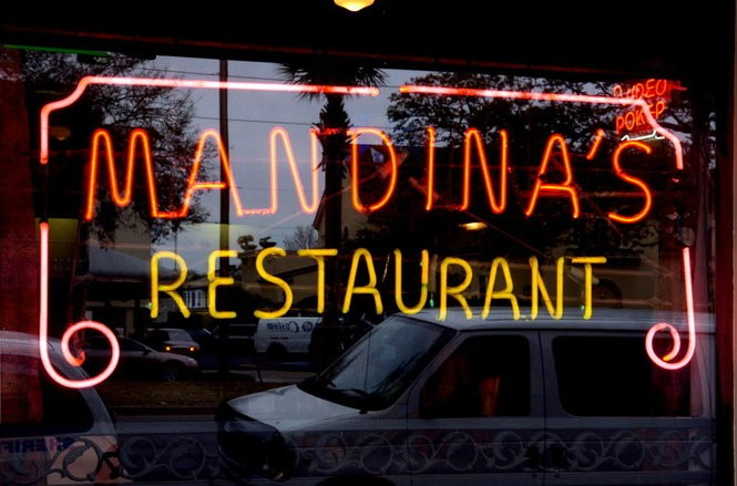 Mandina's iconic neon sign, the spring before the floodwaters from Hurricane Katrina's levee breaches inundated the historic New Orleans restaurant.