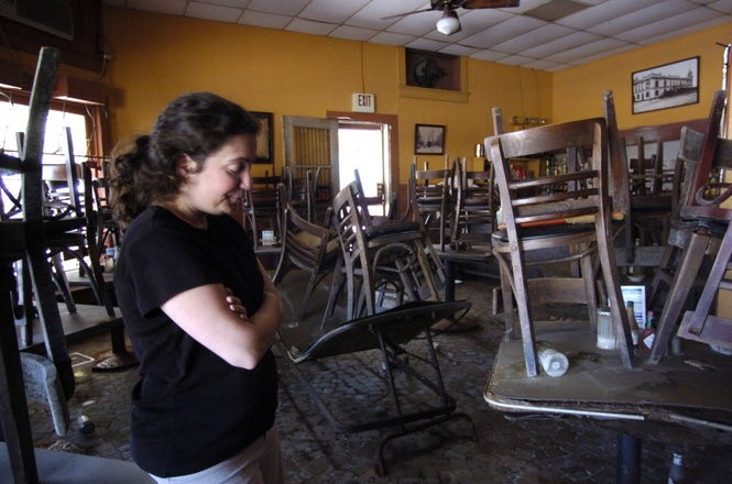 Cindy Mandina stands in the main dining room of her family's flood-damaged restaurant, Mandina's, in October of 2005, just over a month after Hurricane Katrina made landfall.
