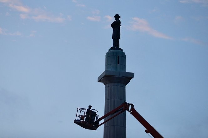 A worker is lifted near the statue of Confederate Gen. Robert E. Lee. The city plans to take down the monument Friday, May 19, 2017. (Photo by Brett Duke, NOLA.com   The Times-Picayune)