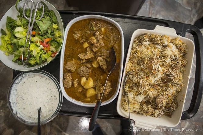 From left, salad, aloo gosht, a Pakistani goat and potato stew; and chicken biryani. (Photo by Chris Granger, NOLA.com | The Times-Picayune)