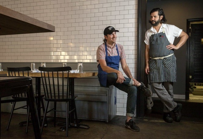 Chef Alfredo Nogueira, right, and Kirk Estopinal, center, co-owner, manager, and bartender at Cafe Henri in New Orleans on Wednesday, March 22, 2017. (Photo by Brett Duke, Nola.com | The Times-Picayune)