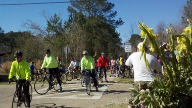 Riders arrive at the scene on the Tammany Trace where 16-year-old Justin Addison was killed last month.
