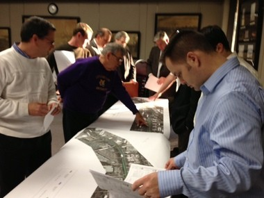 Citizens and engineers go over plans for the widening of a section of U.S. 190 in Mandeville during a public workshop at City Hall Wednesday