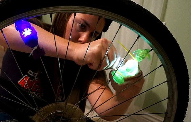 Jennifer Larino making a Mardi Gras sparkle bike (Photo by Doug MacCash/ NOLA.com   The Times-Picayune)