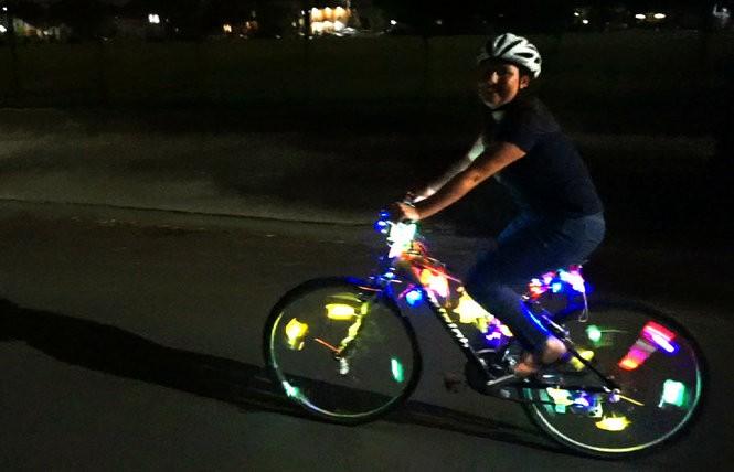 Reporter Jennifer Larino riding a hi-vis Mardi Gras sparkle bike (Photo by Doug MacCash/ NOLA.com   The Times-Picayune)