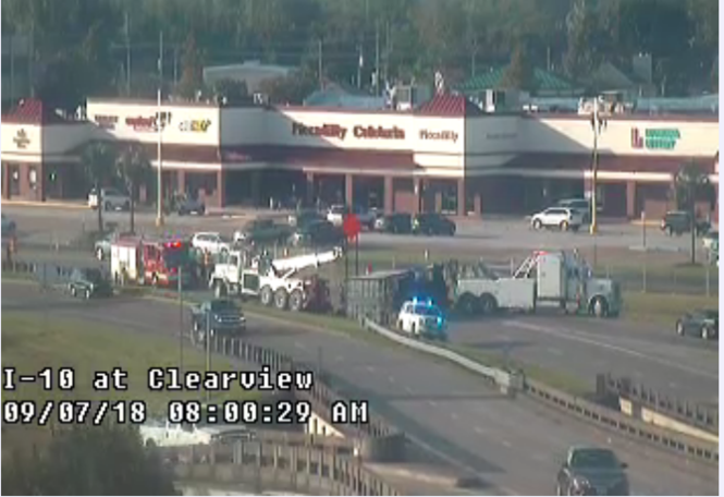 An 18-wheeler overturned at the interchange with Clearview Parkway and I-10 in Metairie. (Image via DOTD traffic camera)