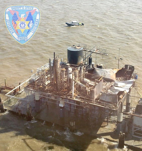 This aerial photo taken Monday, Oct. 16, 2017, shows damage from a fire at a Lake Pontchartrain oil platform the night before. Seven workers at the site were injured and an eighth was still missing Monday afternoon. (Jefferson Parish Sheriff's Office photo)
