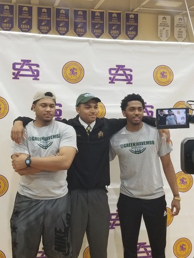 Tulane signee Caleb Daniels with his two brothers, R.J. (left) and Marcel (right)
