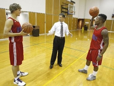 UNO Privateers athletic director Derek Morel chats with basketball players Max Banchy, left, and Rarlensee Nelson shortly after his arrival at UNO in 2012.