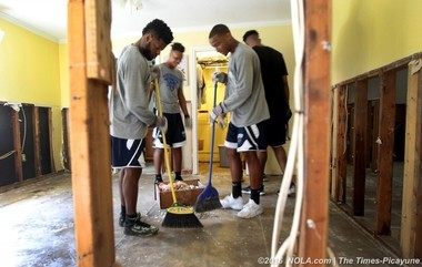 UNO players and coaches conducted relief work for flood victims in Livingston Parish in August 2016.
