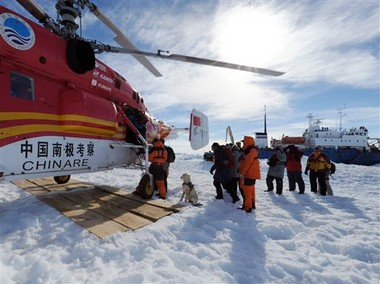Passengers from the trapped Russian vessel MV Akademik Shokalskiy prepare to board the Chinese helicopter Xueying 12 in the Antarctic on Thursday (Jan. 2). A helicopter rescued all 52 passengers from the research ship that has been trapped in Antarctic ice, 1,500 nautical miles south of Hobart, Australia, since Christmas Eve after weather conditions finally cleared enough for the operation.