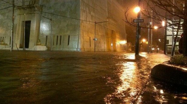 St. Francis Street in downtown Mobile fills with water Tuesday night.
