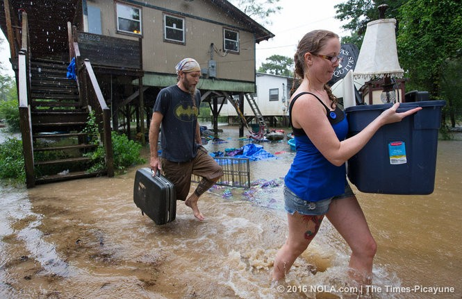Getting out ahead of the flood, Michael Tramonte and Nikki Conger clear their possessions from their house on Watters Road, south of Hwy. 22 and east of Pontchatoula, ahead of the coming flooding Tangipahoa River as storms pound Tangipahoa Parish, Friday, August 12, 2016. The couple was moving anyway, to a new life in Arkansas, and say their timing was perfect. The water reached the deck of the home in the March flooding and the predictions are for a higher crest this weekend. (Photo by Ted Jackson, Nola.com | The Times-Picayune)