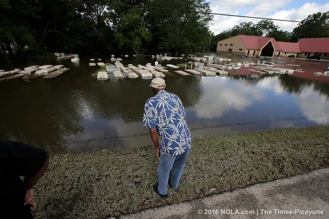 Charles Jiles checks on for his mothers (Matilda Jiles) grave site at the Shady Grove Missionary Baptist Church cemetery in Baker, La., Monday, August 15, 2016. (Photo by David Grunfeld, NOLA.com | The Times-Picayune)