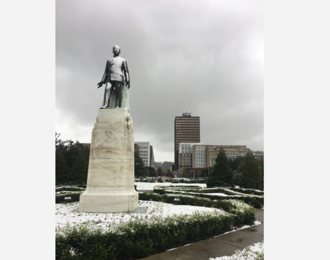 The statue of former Louisiana Gov. Huey P. Long stands in the snow outside the Capitol in Baton Rouge.