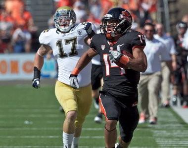 Jordan Poyer returns a kickoff for a touchdown against UCLA.