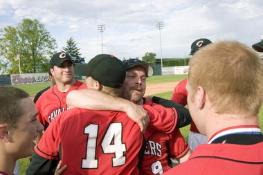 Wetzler and Clackamas High School coach John Arnston, pictured here hugging after the Cavaliers won the 2010 6A state championship, remain in regular contact, helping each other through life's challenges.