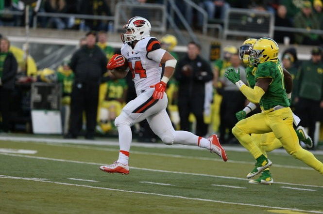 """I'm just a local kid living out a dream,"" Nall said after the 52-42 loss at Oregon. ""To have a game like I did today, I'm blessed."" (Randy L. Rasmussen/Staff)"