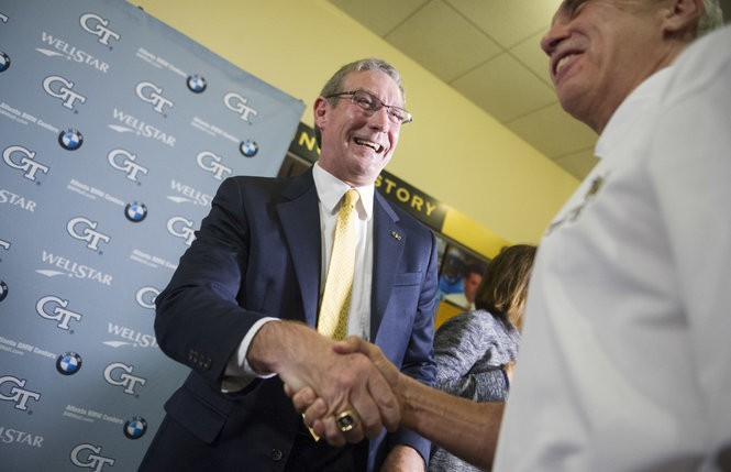 Todd Stansbury is congratulated by former Georgia Tech quarterback Gary Lanier, right, after Stansbury was introduced as Georgia Tech's new athletic director during a news conference, Thursday, Sept. 22, 2016, in Atlanta. Stansbury had served as Oregon State's athletic director since June 2015 and is a former Georgia Tech football player and 1984 alumnus.