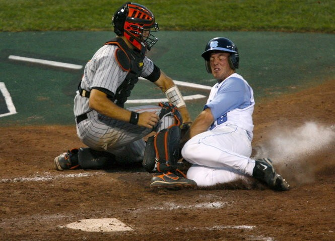 Eleven years after Mitch Canham (left) and his Oregon State Beavers beat Tim Fedroff and the North Carolina Tar Heels to win the 2007 national championship, the Beavers and Tar Heels are set to meet again at the College World Series on Saturday in Omaha, Nebraska.