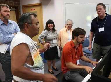 Lloyd Labasan (second from left) dances during a break from rehearsing with Beaverton's Sing Here Now choir. Also pictured are Chris Nelson, the program coordinator; Crystal Akins, the conductor; Melba Rizzo; and Kevin Fillo (far right).
