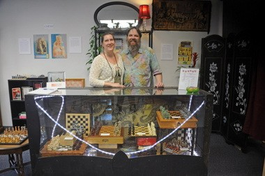 Carol Mathewson (left) and Kyle Engen opened the Interactive Museum of Gaming and Puzzlery in May. They both share a love for historic board games.
