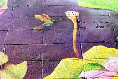 BEAVERTON, OREGON -- AUG. 1, 2014 -- Larry Kangas' wife Sandy and fellow artist Allison McClay, finished this Beaverton mural after his death and added a hummingbird to represent Kangas.