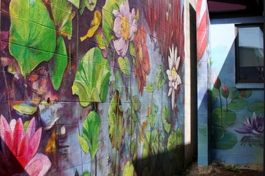 BEAVERTON, OREGON -- AUG. 1, 2014 -- Larry Kangas' wife Sandy and fellow artist Allison McClay finished this Beaverton mural after his death. It's located near 2nd Street and Washington Avenue, at the Holistic Health Clinic.