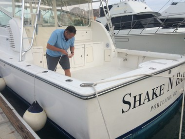 Mike Colbach of Portland prepares his boat, Shake N Bake, for rocking and rolling as a hurricane approaches the harbor at Cabo San Lucas, Mexico.