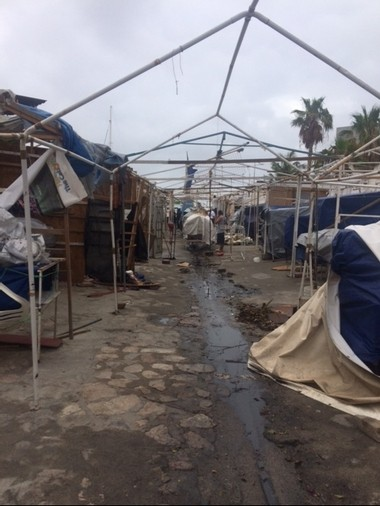 Souvenir alley, leading from Cabo San Lucas to the marina, gets a cleanup Monday after a near-miss by an early hurricane.