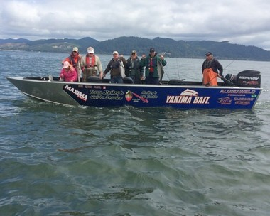 Fishing guide Terry Mulkey with a boatload of happy customers in the Columbia estuary at Buoy 10. The season's first week ended with unusual success for so early in August.