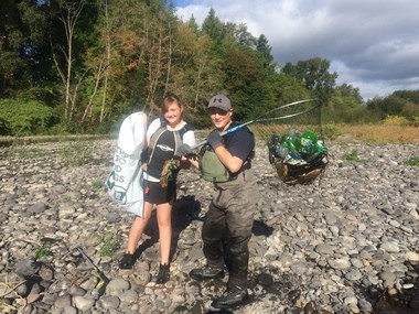 Peyton Pentecost, 13, and her brother Cobey, 15, both of Carver cared enough about the Clackamas River last weekend to help clean up the shoreline after a summer-long stream of rafters and recreationists left their attendant messes.