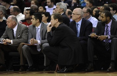 Portland Trail Blazers coach Terry Stotts, front center, and assistant coaches look on in the second half of Friday's game in Houston. They are, from left, front row, Jay Jensen (trainer), Kaleb Canales, Stotts, Jay Triano, David Vanterpool. In second row are assistants KIm Hughes (center) and Dale Osbourne, second row far right.