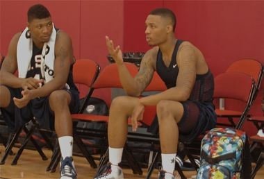 Oklahoma State guard Marcus Smart (left) talks with Portland Trail Blazers guard Damian Lillard at the 2013 USA Basketball mini-camp in Las Vegas
