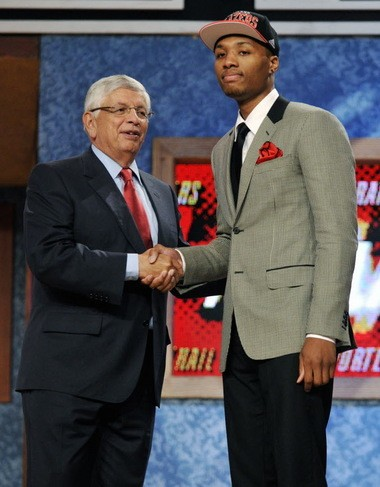 NBA Commissioner David Stern, left, poses with the No. 6 pick Damian Lillard, of Weber State, who was selected by the Portland Trail Blazers in the 2012 NBA draft.