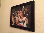 The picture of Lillard with the microphone and Mason in the background is the image he cherishes the most.