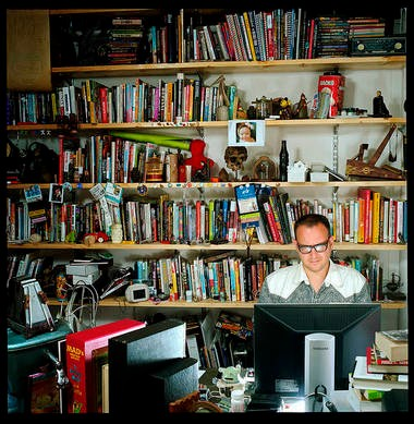 Cory Doctorow at work in his office.