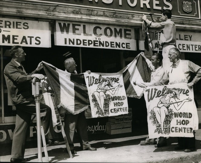 """Welcome signs go up for the Hop Fiesta in Independence in 1948. Author Peter Kopp writes about the festival in his new book """"Hoptopia."""" From left, Robert Craven, parade chairman; Ralph Kletzing, member of the Hop Bowl board; Cecil (Joe) Lamb, president of Hop Bowl Inc., the event sponsor; Tom Smith, bowl member. Nailing sign is Harold Prinus, also a board member."""