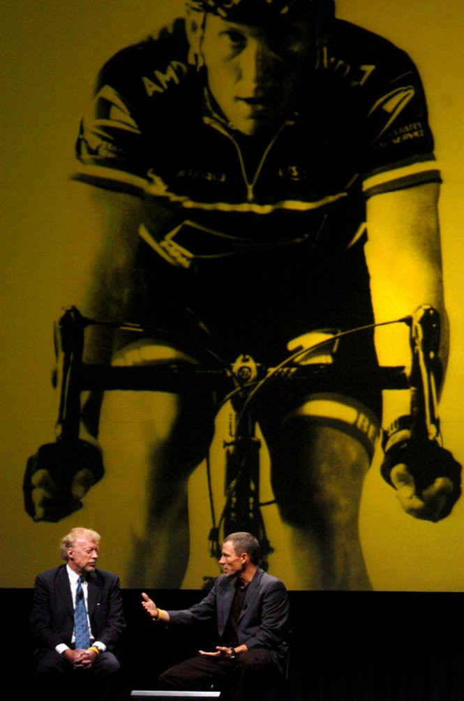 Nike chairman and chief executive officer Phil Knight (left) and celebrity athlete Lance Armstrong at Nike's 2004 shareholders meeting. Many in the crowd wore yellow Livestrong T-shirts in a nod to Armstrong's cancer foundation. (Olivia Bucks/2004)