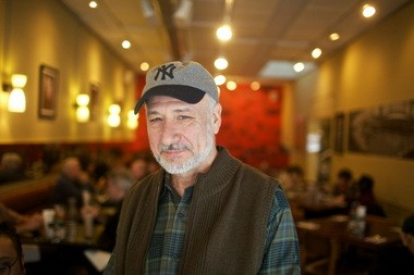 """Laughing Planet Cafe founder Richard Satnick, pictured at his new business, Dick's Kitchen, characterizes himself as """"kind of the thrill-seeker at the beginning of things."""" ."""