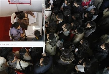 Job seekers wait to submit applications at a job fair in Beijing, China. According to a three-month AP investigation released in January 2013, five years after the start of the Great Recession, millions of middle-class jobs have disappeared from the global economy and aren't just being lost to China and other developing countries.