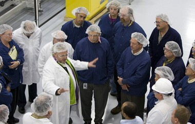 Frank Asbeck, SolarWorld CEO from Germany, talked with some the company's employees at the Hillsboro plant when he visited in October 2010.  He says SolarWorld will survive its fiscal crisis.