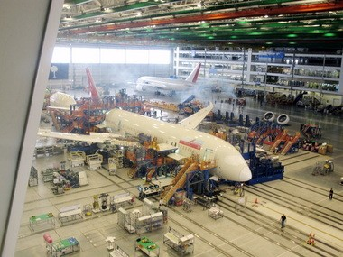 In this April 27, 2012, photo, workers at Boeing's assembly plant in North Charleston, S.C. assemble a 787 jetliner.