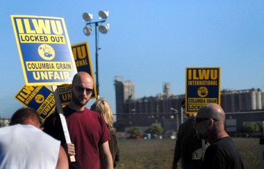Picketers protest outside Columbia Grain on Saturday at Port of Portland's Terminal 5.